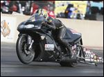 Karen Stoffer races at the NHRA Nationals at Summit Motorsports Park. Stoffer won only the second all-female NHRA Pro Stock Motorcycle final.