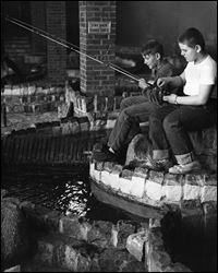 Left to right: Scott Butterfield (9)  and Jerry Danford (11) at the Trout Stream in the Toledo Zoo Aquarium on April 18, 1963