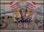 Artists Douglas Kampfer and Natalie Lanese have planned a 70-foot-by-30-foot mural featuring Moses Fleetwood Walker, the first African American to play major league baseball, and other Toledo treasures. Their mural will dress up 19 S. St. Clair St.