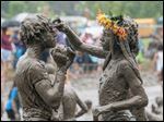 Caprise Debose, left, and Kaliyah Watson, of Westland, play together during the annual Mud Day at Nankin Mills Park in Westland, Mich. on Tuesday.