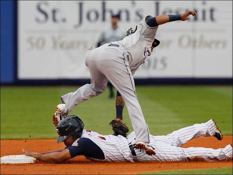 Mud Hens second baseman Alexi Casilla steals second base against Columbus Clippers second baseman Michael Martinez during the second inning.
