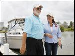 Capt. Dave Spangler talks to Lt. Governor Mary Taylor on Wednesday at Wild Wings Marina in Oak Harbor.