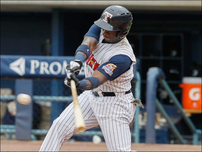 Mud Hens DH Trayvon Robinson singles against the Columbus Clippers during the first inning.