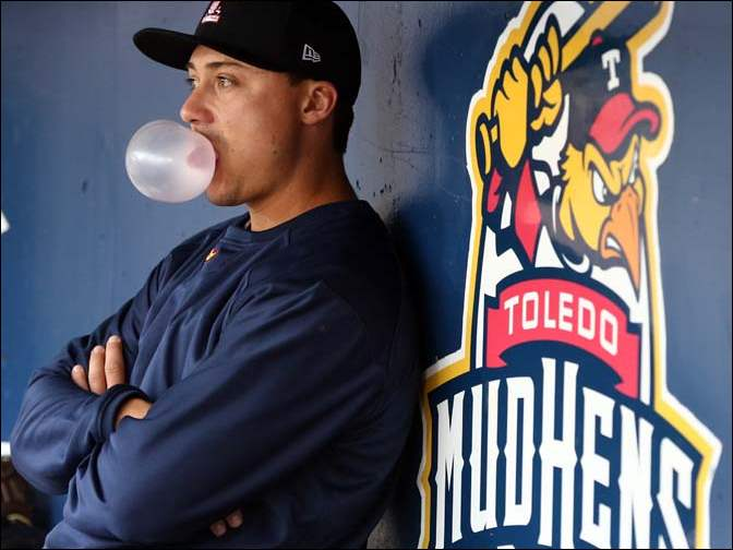 Toledo second baseman Corey Jones blows a bubble in the dugout during a baseball game against the Columbus Clippers.