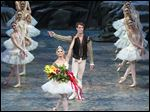 Misty Copeland and James Whiteside acknowledge the audience after appearing in