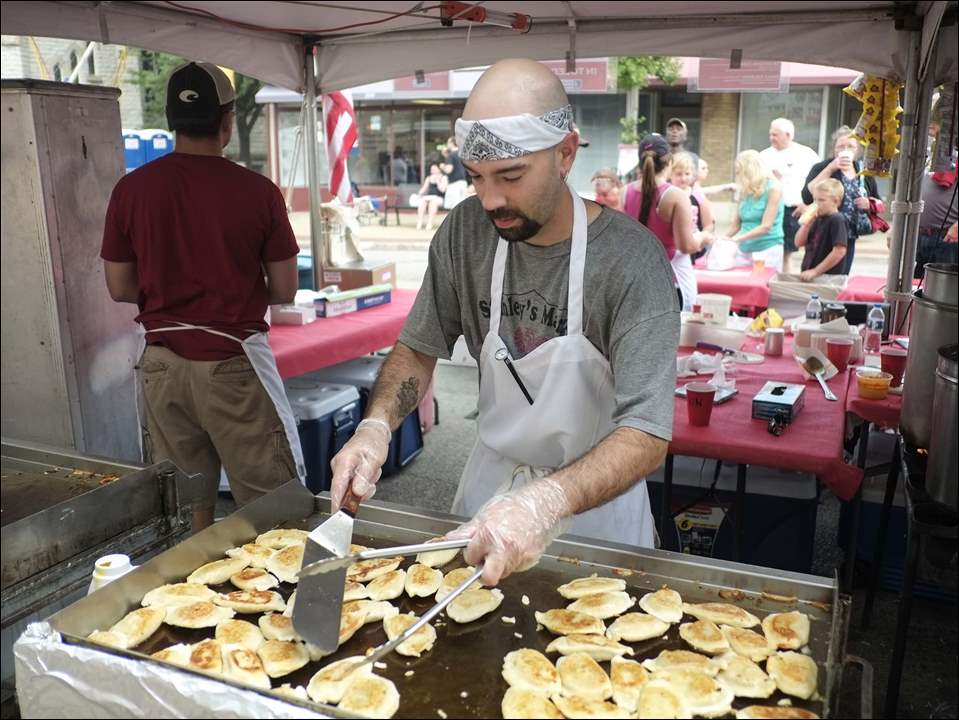 Vincent Cope, assistant manager Stanley's Market in Toledo, fries up potato and cheese pierogies.