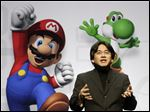 Satoru Iwata, President and CEO of Nintendo Co. Ltd., speaks at a news conference where Nintendo unveiled an enhancement for its Wii Remote controller and new games at the E3 Media and Business Summit in Los Angeles in July, 2008.