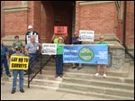 Demonstrators gather on the steps of the Fulton County Courthouse in Wauseon in July to protest the Nexus pipeline.