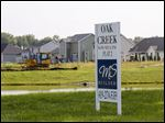 New-home construction is evidence of a hot market across the state line in Michigan.