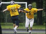 Gold wide receiver Scott Freeman, a Perrysburg grad, runs to celebrate his touchdown with Matt Brumbaugh from Toledo Christian during the Northwest Ohio Regional all-star game.