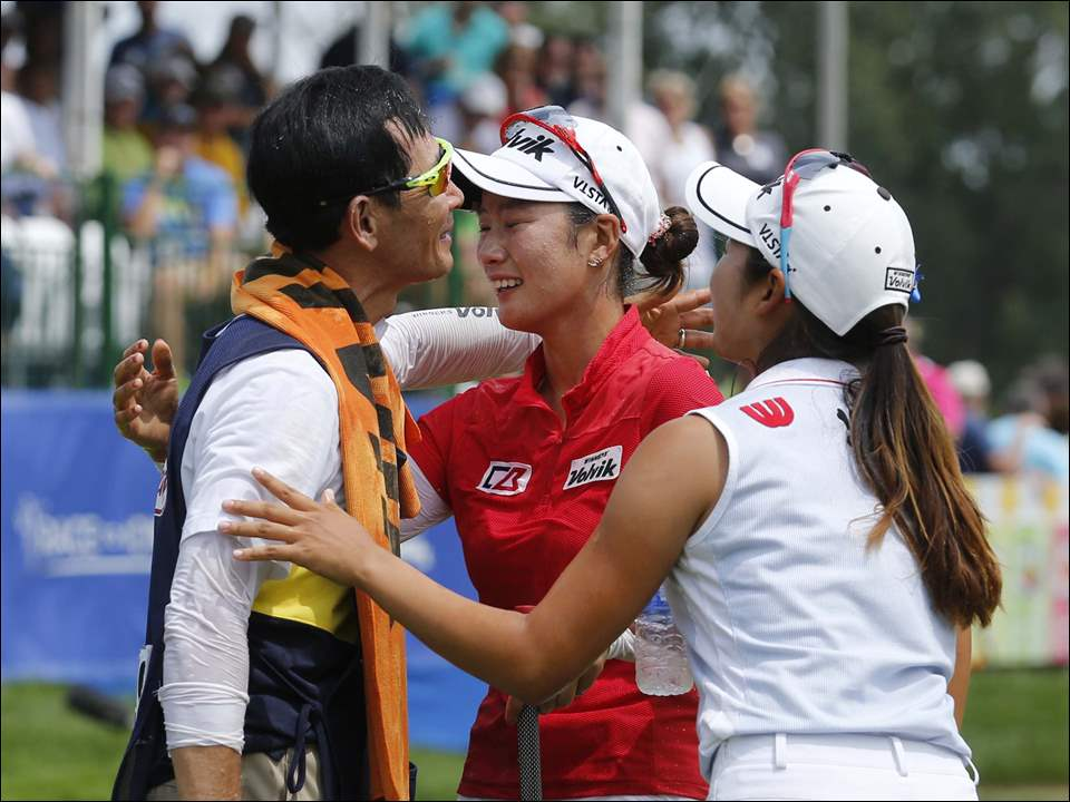 Chella Choi, center, celebrates with her father Ji Yeon Choi and Hyang Lee, right, after winning the LPGA Marathon Classic.