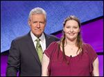 Oregon native Erin Saelzler appears with 'Jeopardy!' host Alex Trebek. She will be a contestant on an episode airing Thursday. Of her experience on the show, Ms. Saelzler compared it to 'being in a giant video game.'