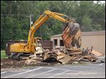 Bedford Schools proceeded with demolition of seven portable classrooms outside of Bedford High School.