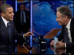 President Obama talks with Jon Stewart during a taping of his appearance in October, 2012.
