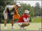 Chella Choi and her father and caddy Ji Yeom Choi assess her putt on hole No. 18 during the fourth and final round of the Marathon Classic Sunday.