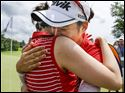 Chella Choi, right, gets a hug from her sister Haejung Choi after defeating Ha Na Jang in a one-hole playoff to win the 2015 LPGA Marathon Classic presented by Owens Corning & O-I at Highland Meadows Golf Club, Sunday, July 19,  2015.