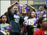Workers hold a rally in support of the Los Angeles County Board of Supervisors' proposed minimum wage ordinance, in Los Angeles, on Tuesday.