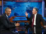 President Barack Obama, left, talks with Jon Stewart, host of