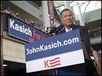 Gov. John Kasich announces his candidacy for president before a crowd at Ohio State University on Tuesday.