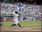 Milwaukee Brewers' Jean Segura hits a two-run home run during the second inning of a baseball game against the Cleveland Indians Tuesday in Milwaukee.