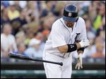 Detroit Tigers' Nick Castellanos flips away his bat after hitting a grand slam.