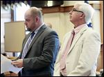 State Rep. Steven Kraus, right, with his attorney Troy Murphy, says he was asked to evaluate the property, from where he is accused of stealing antiques.