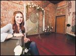 Jessica Kozak in her new business, Simply Married, in downtown Toledo. The business, kitty-corner to the Lucas County Courthouse, offers an alternative site for a wedding.