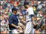 Detroit Tigers pitcher David Price, right,  heads for the dugout after being pulled by manager Brad Ausmus during the eighth inning.