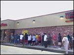 People line up for a chance to get free pizza at the new Mar-co's Pizza on South Avenue near the Anthony Wayne Trail.