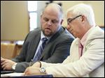 State Rep. Steven Kraus, right, confers with his attorney, Troy Murphy, during his trial in Port Clinton.