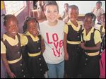 Joy Grayczyk with students during a mission trip at a school in Malvern, St. Elizabeth, Jamaica.