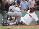 The Red Sox's David Ortiz, right, is tagged out at home by Tigers catcher James McCann after a single by Hanley Ramirez in the second inning.