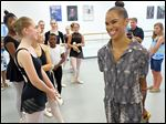 Misty Copeland, right, the first African-American principal ballerina of the prestigious American Ballet Theatre, greets dancers at the Ballet Theatre of Toledo in Holland.