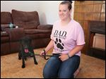 Ashley Kinstler of Toledo paid $15,000 for a diabetic alert dog, but she received Keona, a 2-year-old British Labrador retriever that is not trained as a service animal. Miss Kinstler is one of more than a dozen people filing a lawsuit against Texas-based Drey's Alert Dogs.