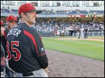Clay High School graduate and longtime Toledo Mud Hens fan A.J. Achter sits in the dugout for the Rochester Red Wings during game against the Toledo Mud Hens at Fifth Third Field.