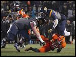 University of Toledo's Kareem Hunt, right, leaps over Bowling Green State University's Ryland Ward (15) during the football game at the Glass Bowl last November.