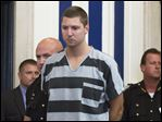 Former University of Cincinnati police officer Ray Tensing appears at Hamilton County Courthouse for his arraignment in the shooting death of motorist Samuel DuBose, today, in Cincinnati.