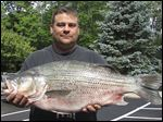Richard Knisley caught a hybrid striper that weighed 18.32 pounds, an Ohio record. He caught it at Deer Creek Lake.