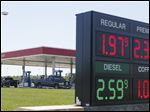 People get gas Friday at the Meijer gas station on East Alexis Road near Hagman Road in Toledo. Gas was $1.97 a gallon.