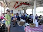 Kris Patterson, executive director for Partners for Clean Streams, speaks to 48 passengers aboard the Sandpiper during a special two-hour educational cruise Sunday.