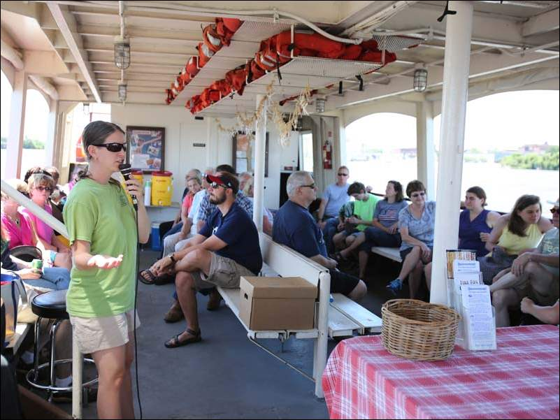 Kris Patterson, executive director, Partners for Clean Streams, speaks during a special cruise on the Sandpiper in commemoration of the one-year anniversary of the Toledo water crisis.