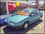 Joe's Autos in Sylvania Township will hold a drawing to give away a 1995 Saturn SL1 with a retail price of $2,999.25.