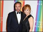 Narvel Blackstock and Reba McEntire announced in a joint statement that they have worked together for 35 years and will continue to do so.