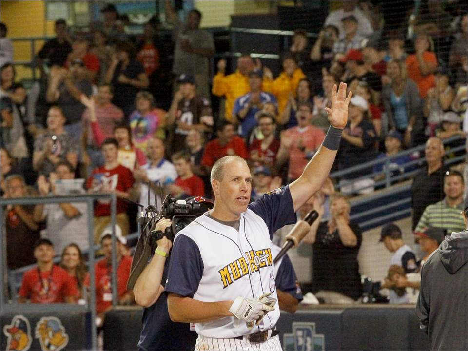 Toledo's Mike Hessman waves to a standing ovation after hitting a grand slam. The hit was Hessman's 433rd home run, earning him the record for most home runs in the affiliated minor leagues.