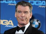 FILE - In this Feb. 7, 2015 file photo, Pierce Brosnan attends the Press Room at the 67th Annual DGA Awards, in Los Angeles. Police say former James Bond actor Brosnan has been stopped at a Vermont airport security checkpoint because of a knife he was carrying. Burlington Police Department Lt. Shawn Burke says airport authorities told him about Brosnan's encounter with Transportation Security Administration agents. He said Tuesday, Aug. 4, 2015, that police wouldn't be called to Burlington International Airport for such an incident and they don't have a report on it.