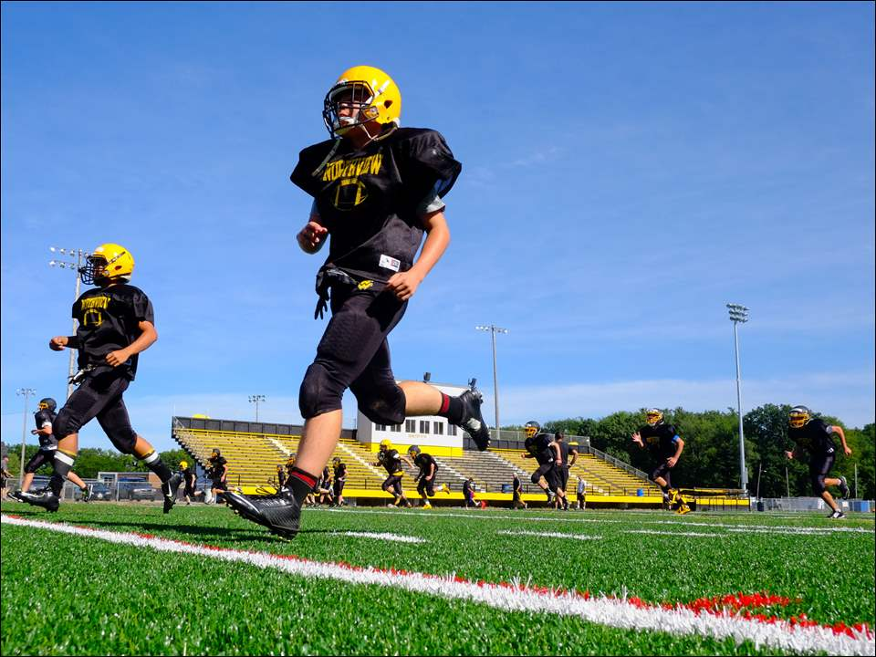 Sylvania Northview football players practice on the their new turf field Thursday.