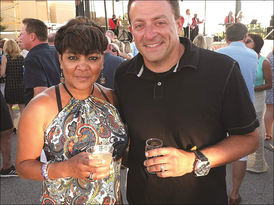 Kim McGee-Pfitzer and Mike Skaff during the Toledo Regional Chamber of Commerce Clambake on July 30 at the Hollywood Casino in Toledo.