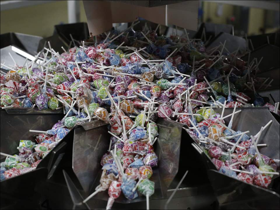 Mixed flavors of Dum Dum pops are ready to be packaged.