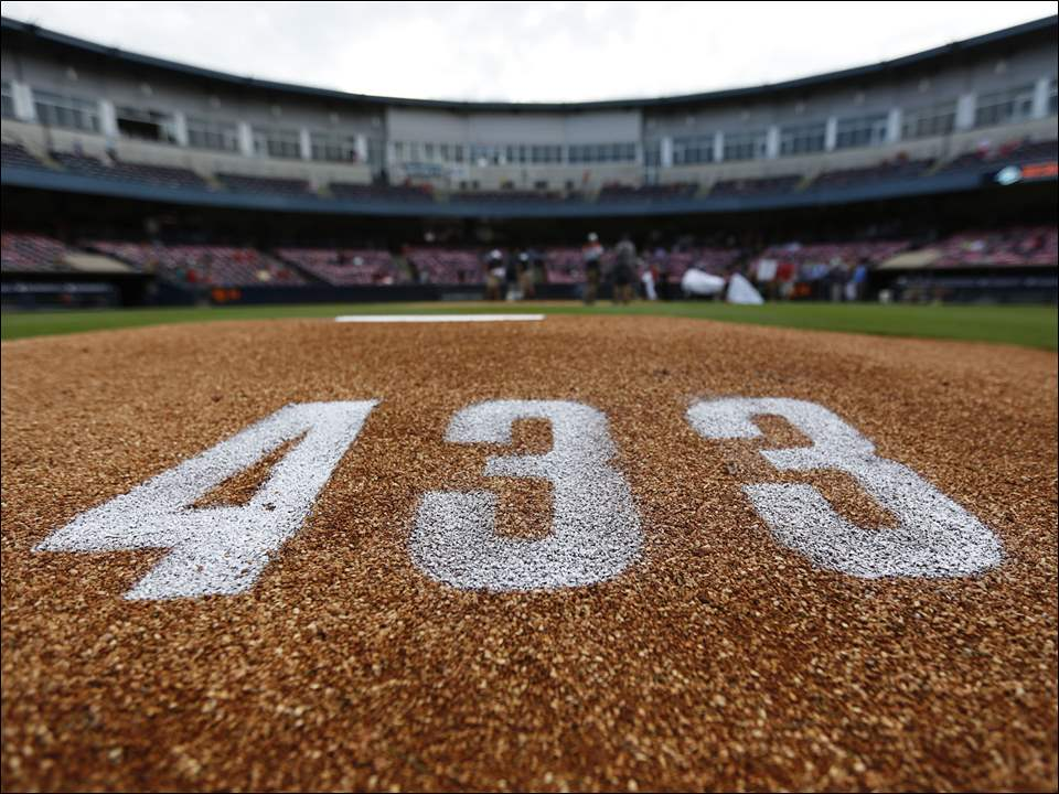 433 is painted on the pitchers mound in honor of Toledo Mud Hens' Mike Hessman before the Hens play Scranton/Wilkes-Barre at Fifth Third Field Friday. Hessman hit his 433rd home run earlier in the week to break the minor league record for home runs.