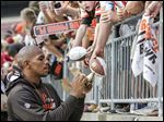 Despite a five-year ban from Ohio State, Browns receiver and former Buckeye Terrelle Pryor signs autographs after practice at Ohio Stadium.
